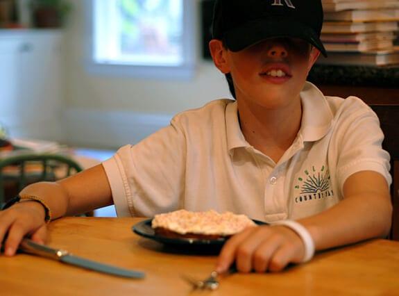eating six layer white cake child