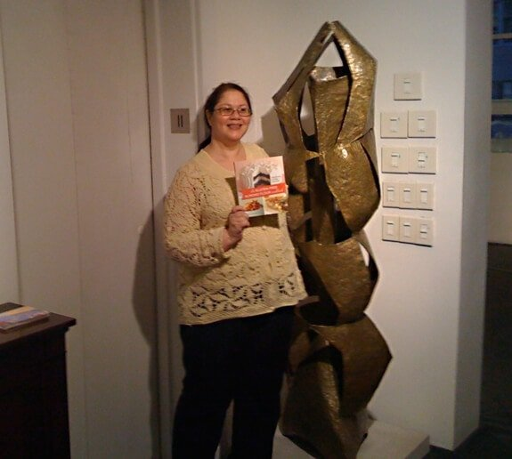 Sara with the Gluten Free Almonf Flour Cookbook at Babcock Galleries